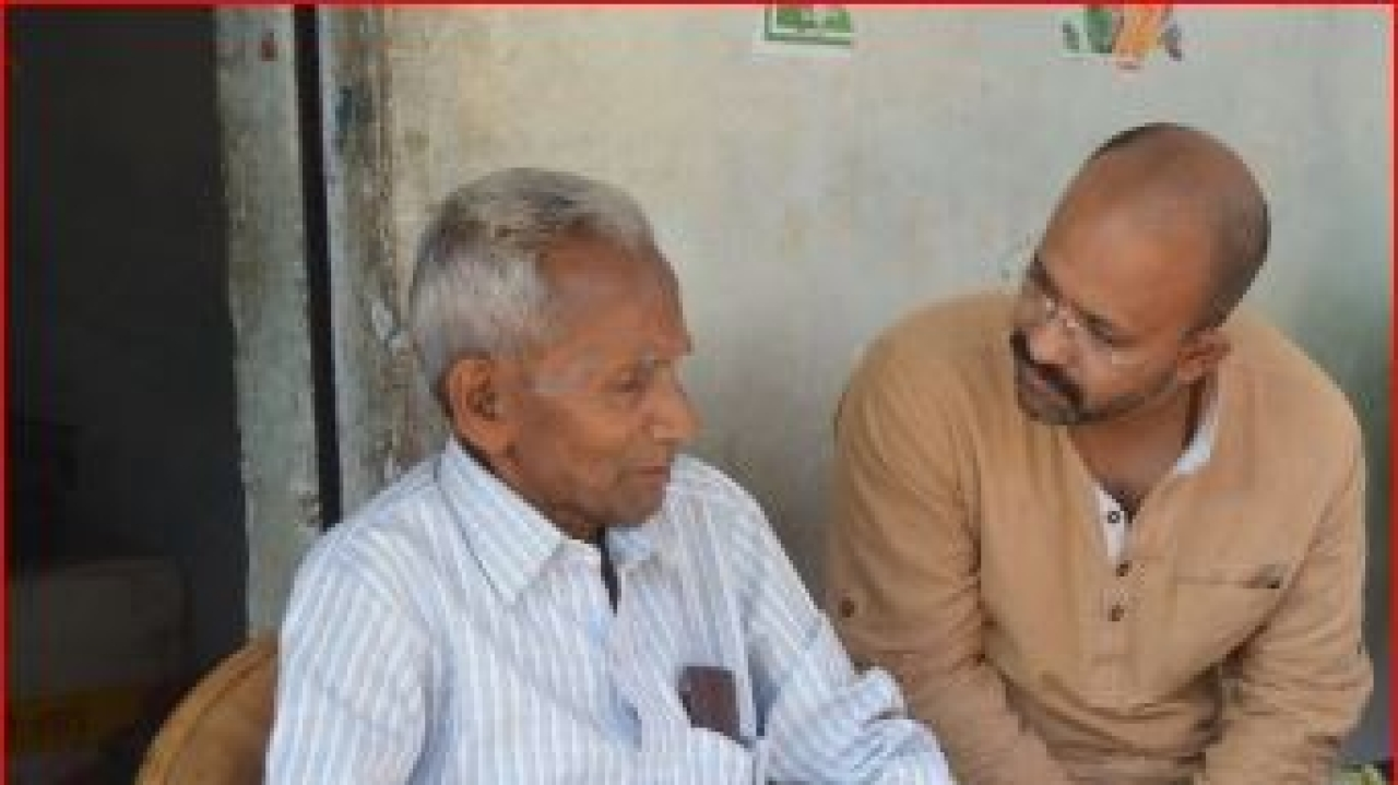 The author with Adityanath's father, Anand Singh Bisht