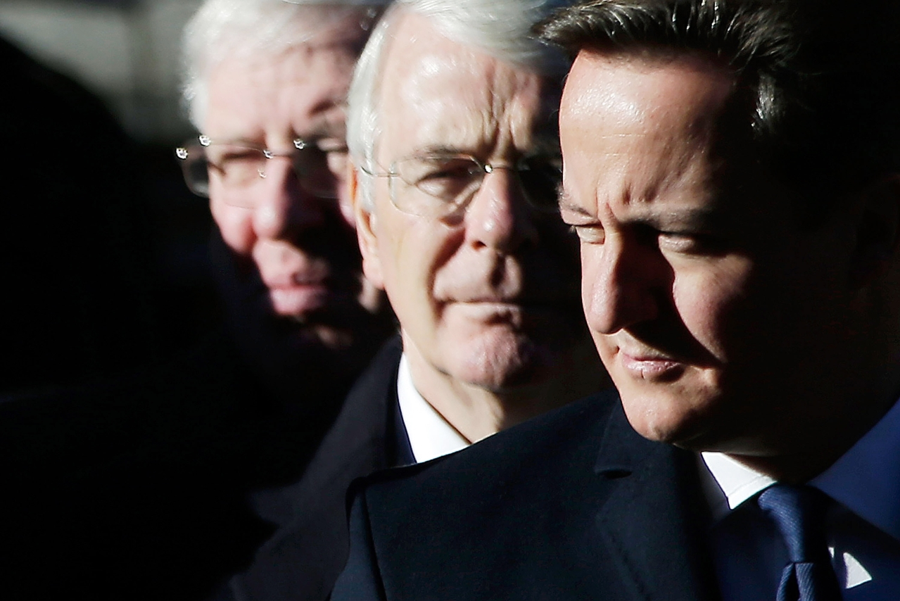 Former British Prime Ministers Sir John Major (C) and David Cameron (R) (Matthew Lloyd/Getty Images)