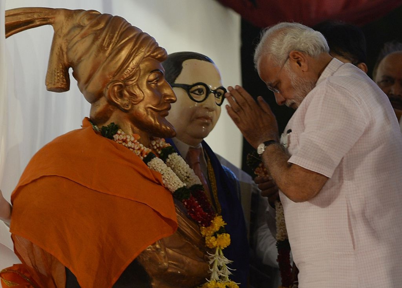 Prime Minister Narendra Modi pays his respects to Chattrapati Shivaji and the architect of India's Constitution B R Abedkar before addressing an election rally in Mumbai. (INDRANIL MUKHERJEE/AFP/GettyImages)
