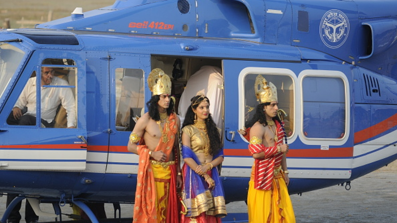 Artistes dressed up as Lord Rama, Sita and Lakshman who arrived by a chopper for Deepotsav celebrations on October 18, 2017 in Ayodhya, India. More than 1.7 lakh earthen lamps were lit up at the grand event while a chopper decorated as the mythological Pushpak Viman descended on the Ram Katha Park (Deepak Gupta/Hindustan Times)