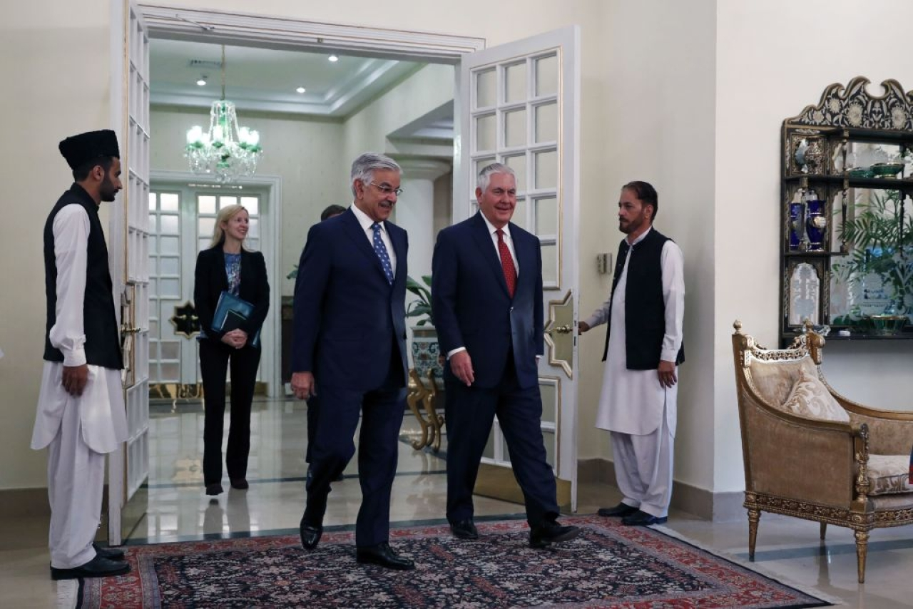 Rex Tillerson (second right) walks with  Khawaja Asif as he arrives at the Prime Minister's residence in Islamabad on 24 October 2017. (ALEX BRANDON/AFP/GettyImages)