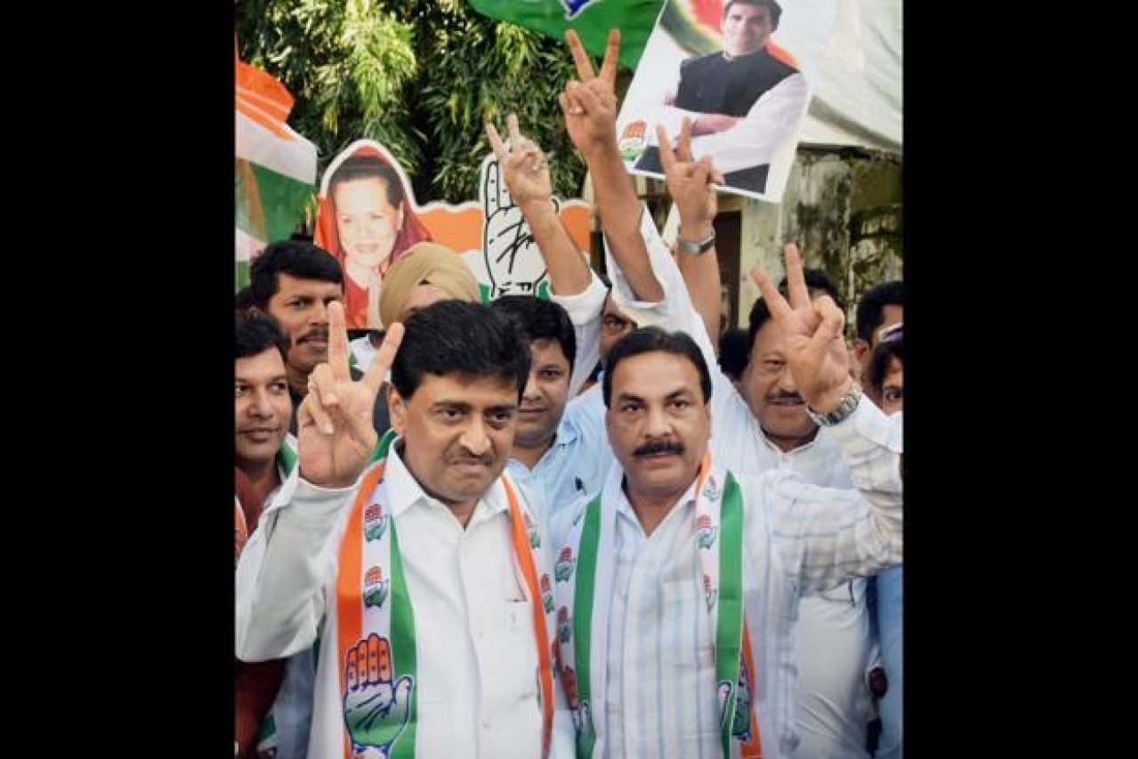 Maharashtra Congress chief Ashok Chavan (left) and party workers celebrate the party's win in the Nanded municipal elections. (PTI)