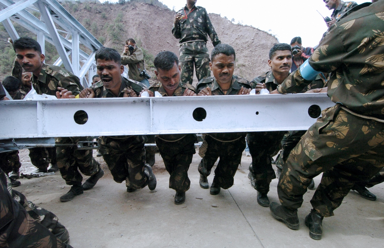 Indian army soldiers work to rebuild a bridge (Sajjad Hussain/AFP/Getty Images)