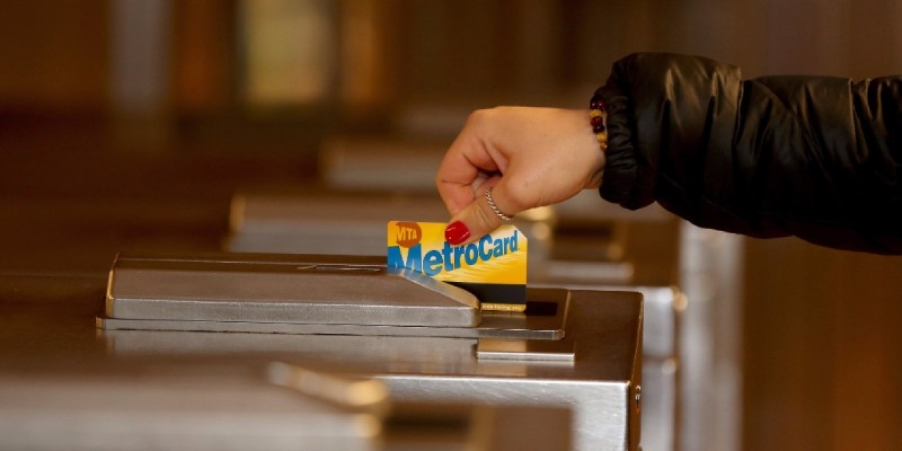 A woman swipes her MetroCard in New York (ANADOLU AGENCY VIA GETTY IMAGES)