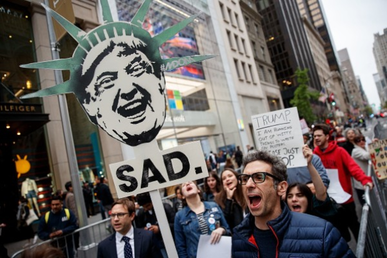 Protestors rally against President Donald Trump and his policies down the street from Trump Tower in New York City. (Drew Angerer/Getty Images)