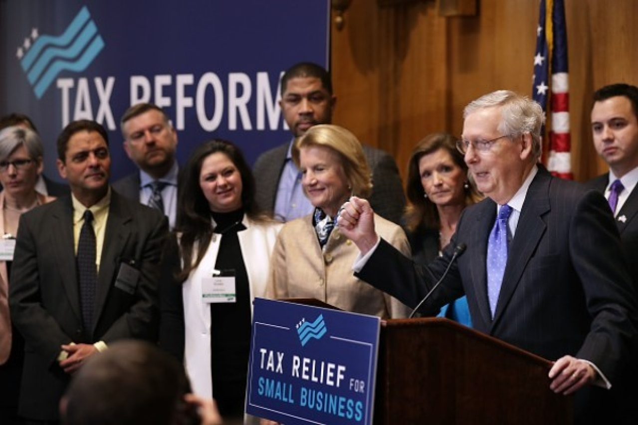 Pumping his fist, Senate Majority Leader Mitch McConnell (R-KY) addresses a tax reform news conference with Sen. Shelley Moore Capito (R-WV)  on Capitol Hill in Washington, DC. (Chip Somodevilla/Getty Images)