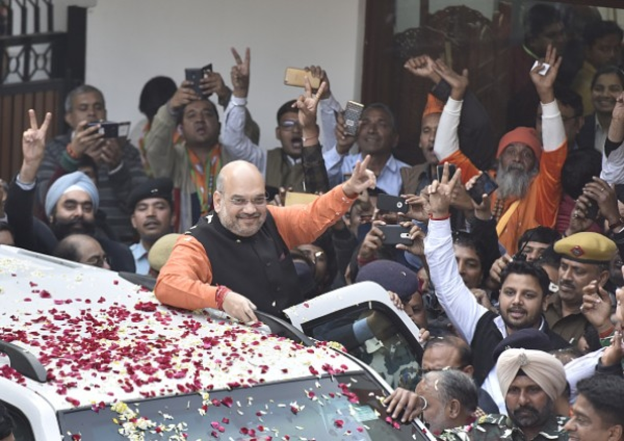 BJP national president Amit Shah greets party workers as they celebrate after the party is projected for victories in Gujarat and Himachal Pradesh elections. (Sonu Mehta/Hindustan Times via Getty Images)