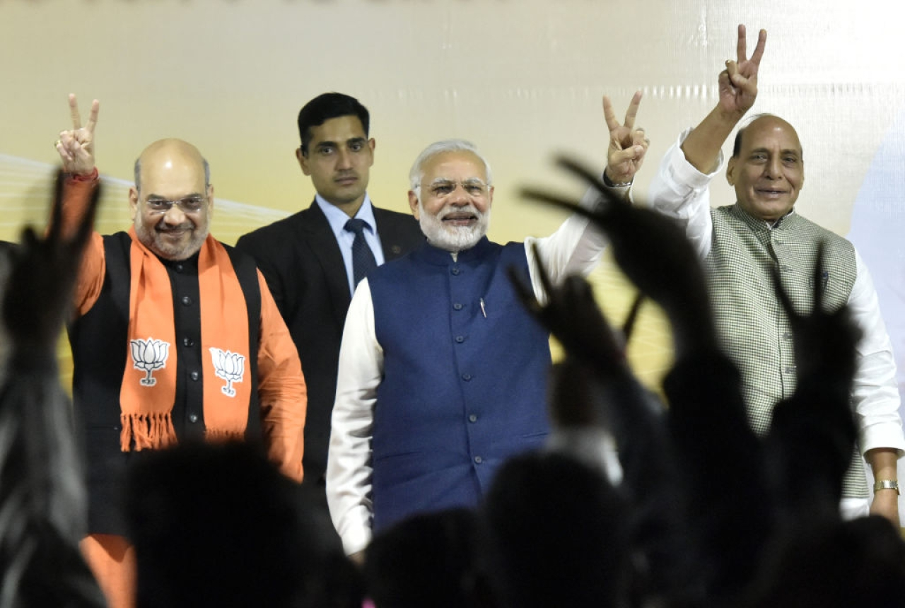 Prime Minister Narender Modi, BJP national president Amit Shah and Home Minister Rajnath Singh greet BJP workers after winning Gujarat and Himachal Pradesh elections at the party headquarters in New Delhi. (Sonu Mehta/Hindustan Times via GettyImages)