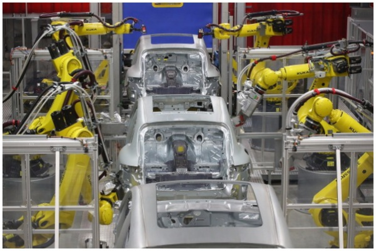 Robots weld the bodies of Porsche Macan SUVs at the new Porsche Macan factory at the Porsche plant on February 11, 2014 in Leipzig, Germany. (Sean Gallup/Getty Images)