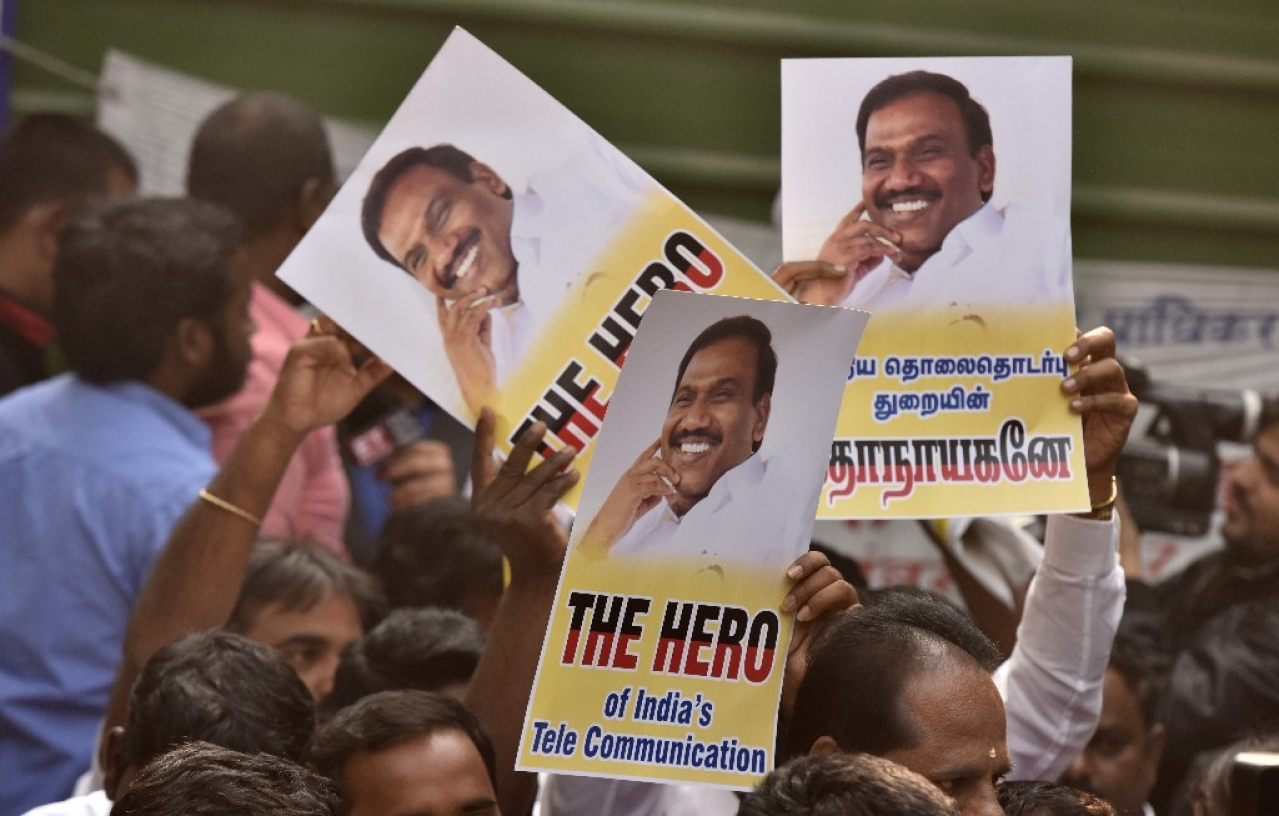 Supporters of former telecom minister A Raja celebrating after 2G case verdict in New Delhi. (Sonu Mehta/Hindustan Times via GettyImages)