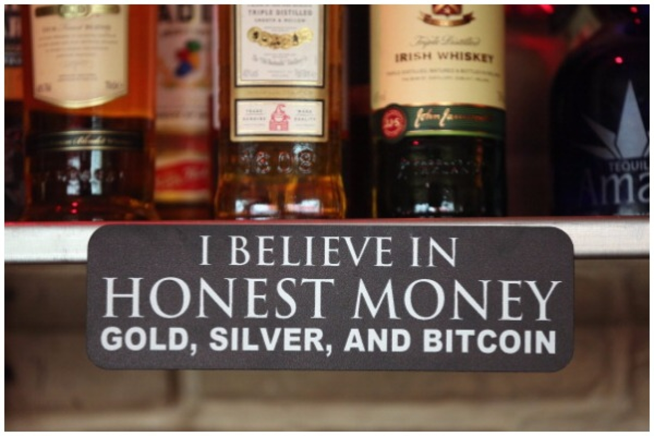 A sign announces a proprieter's loyalty to Bitcoins, where they are also accepted for payment, at a pub on April 11, 2013 in Berlin, Germany. (Sean Gallup/Getty Images)