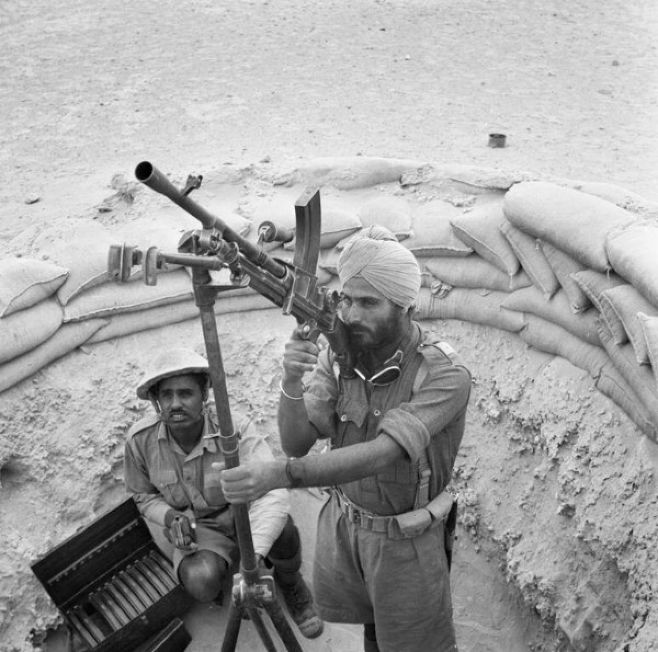 "Indian soldiers operating a Bren Gun, a standard Light Machine Gun used by Commonwealth Troops, Egypt 1941. (<a href=""https://en.wikipedia.org/wiki/Bren_light_machine_gun#/media/File:Anti-aircraft_BrenGun.jpg"">Wikipedia</a>)"
