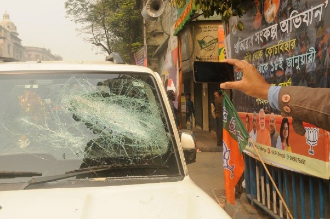 A BJP supporter's damaged car in front of the party office after tension between BJP and Trinamool supporters in Kolkata. (Samir Jana/Hindustan Times via Getty Images)