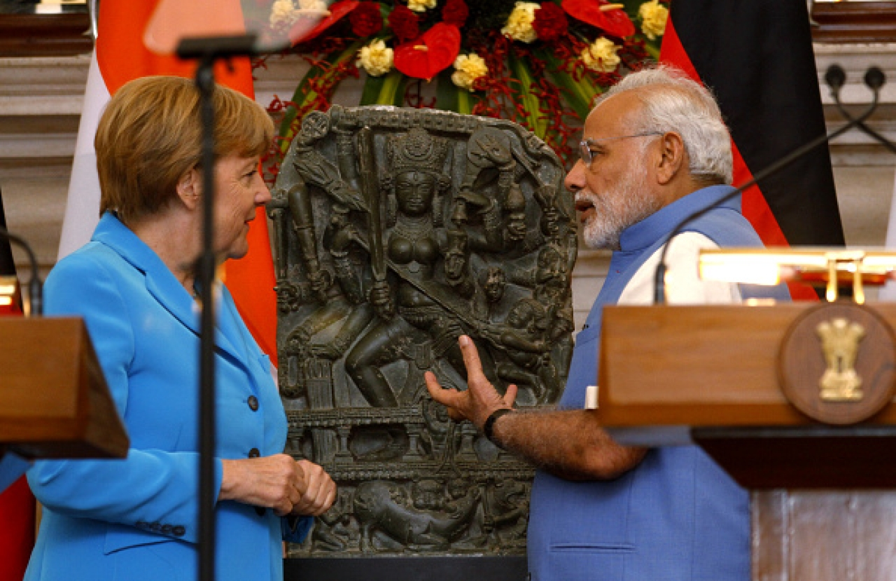 PM Modi with German Chancellor Angela Merkel as she returns a tenth century Durga idol from Kashmir. (Virendra Singh Gosain/Hindustan Times via Getty Images)