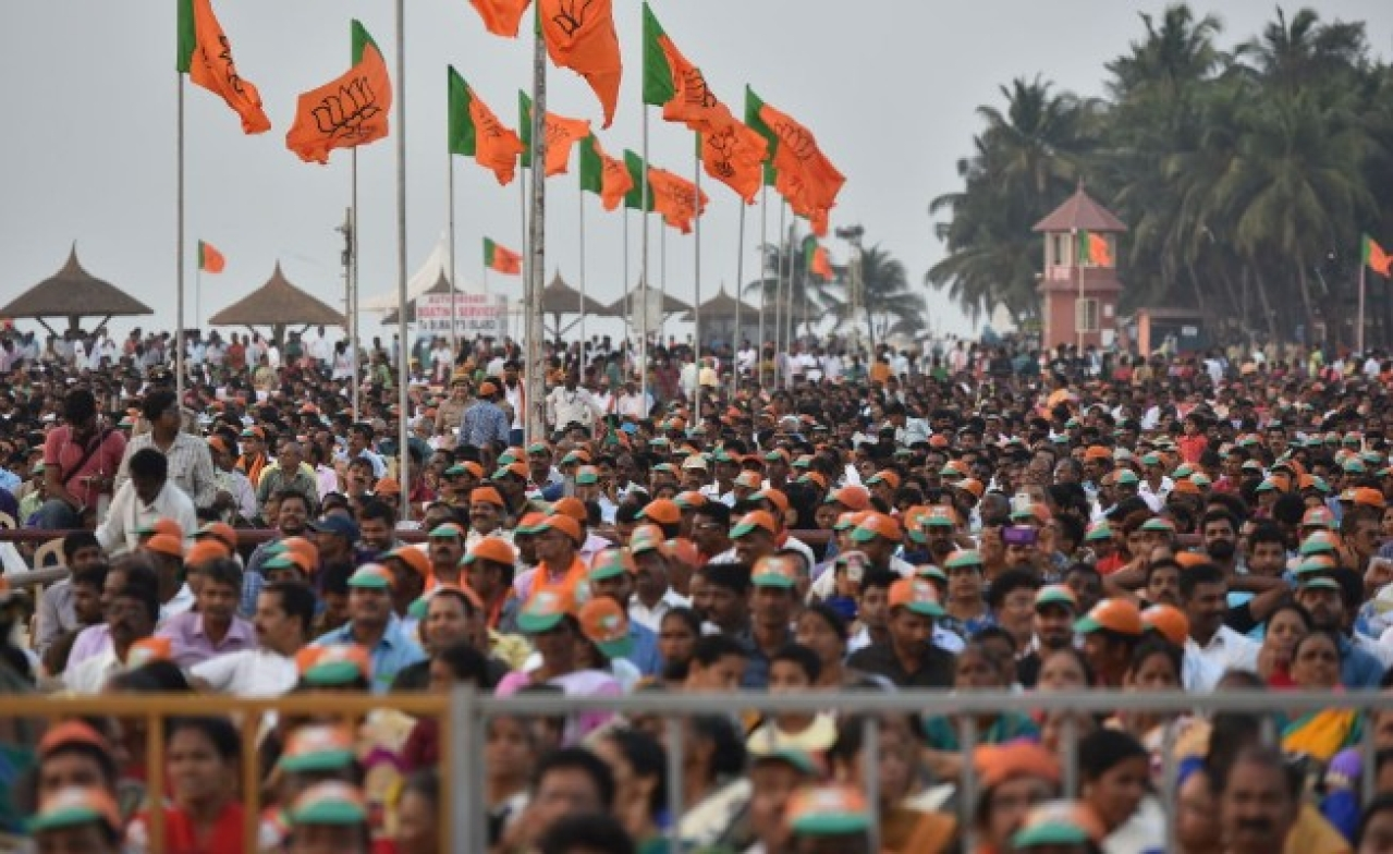 People gathered at Maple beach for BJP national President Amit Shah's speech during Fishermen's convention at Maple beach on February 20, 2018 in Udupi, India. (Arijit Sen/Hindustan Times via Getty Images)