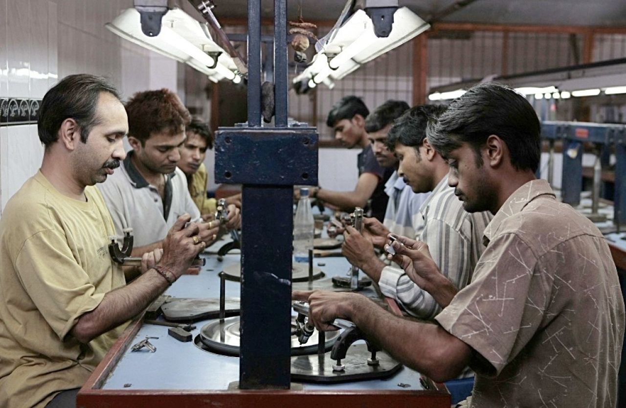 Workers busy polishing diamonds at a factory in Dahisar. (Satish Bate/Hindustan Times via Getty Images)