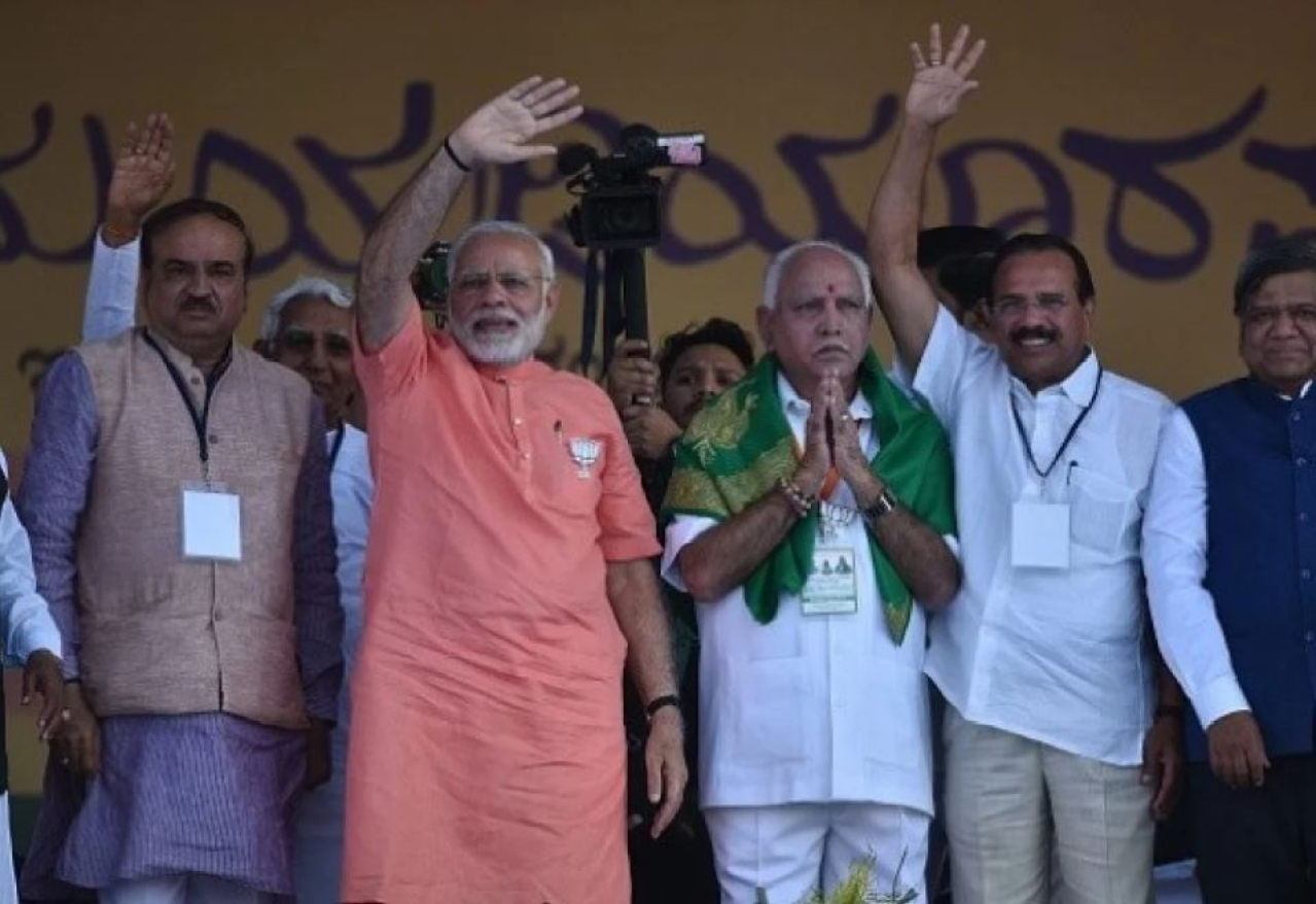 Prime Minister Narendra Modi with BJP's chief ministerial candidate for upcoming Karnataka assembly election B S Yeddyurappa at a rally. (Arijit Sen/Hindustan Times via GettyImages)