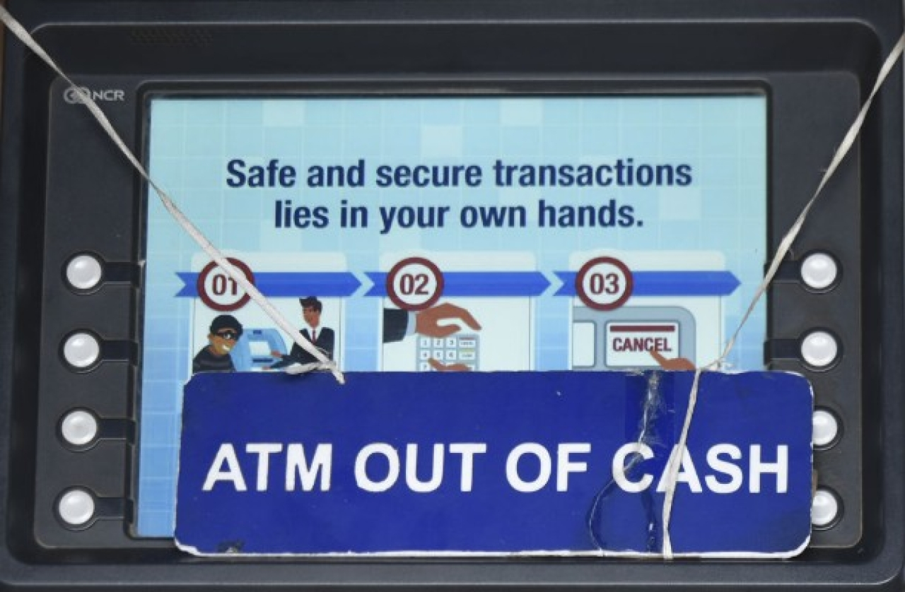 An ATM with a sign board showing no cash at Bengali Market, near Mandi House, on 17 April 2018 in New Delhi. (Vipin Kumar/Hindustan Times via Getty Images)