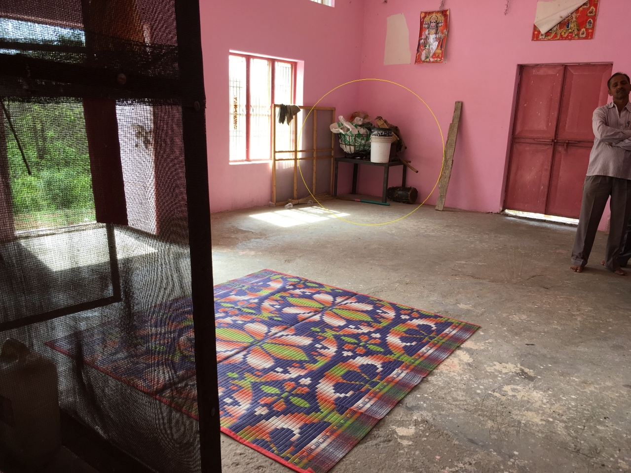 Inside the one-room Devasthan. View from the raised platform where idols are kept. The 4X3 feet iron table is the one beneath which the the eight-year-old girl was allegedly kept