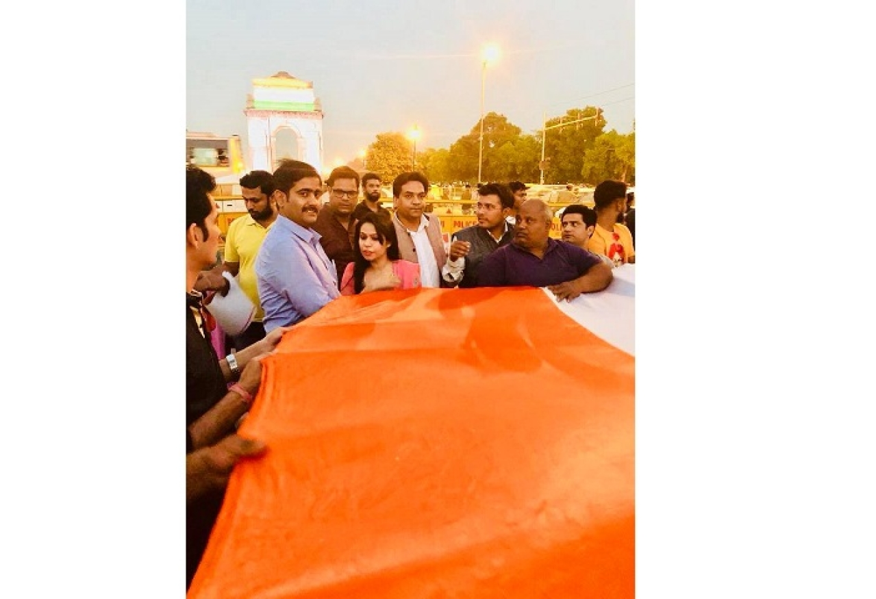 Demonstrators with the giant India flag at the India Gate.