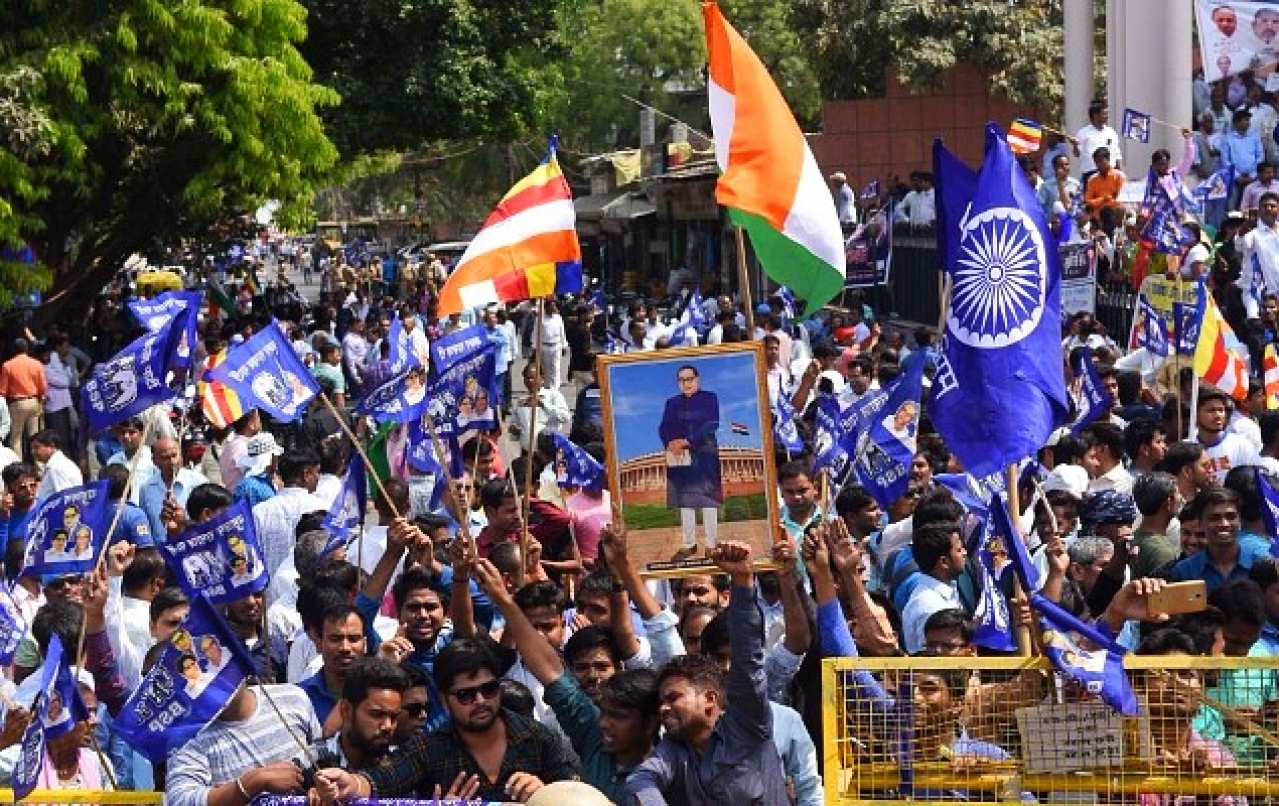 Dalits staging a protest during the Bharat <i>bandh</i> called by several Dalit organisations to protest against a Supreme Court order which allegedly dilutes a law protecting their rights. (Subhankar Chakraborty/Hindustan Times via Getty Images)