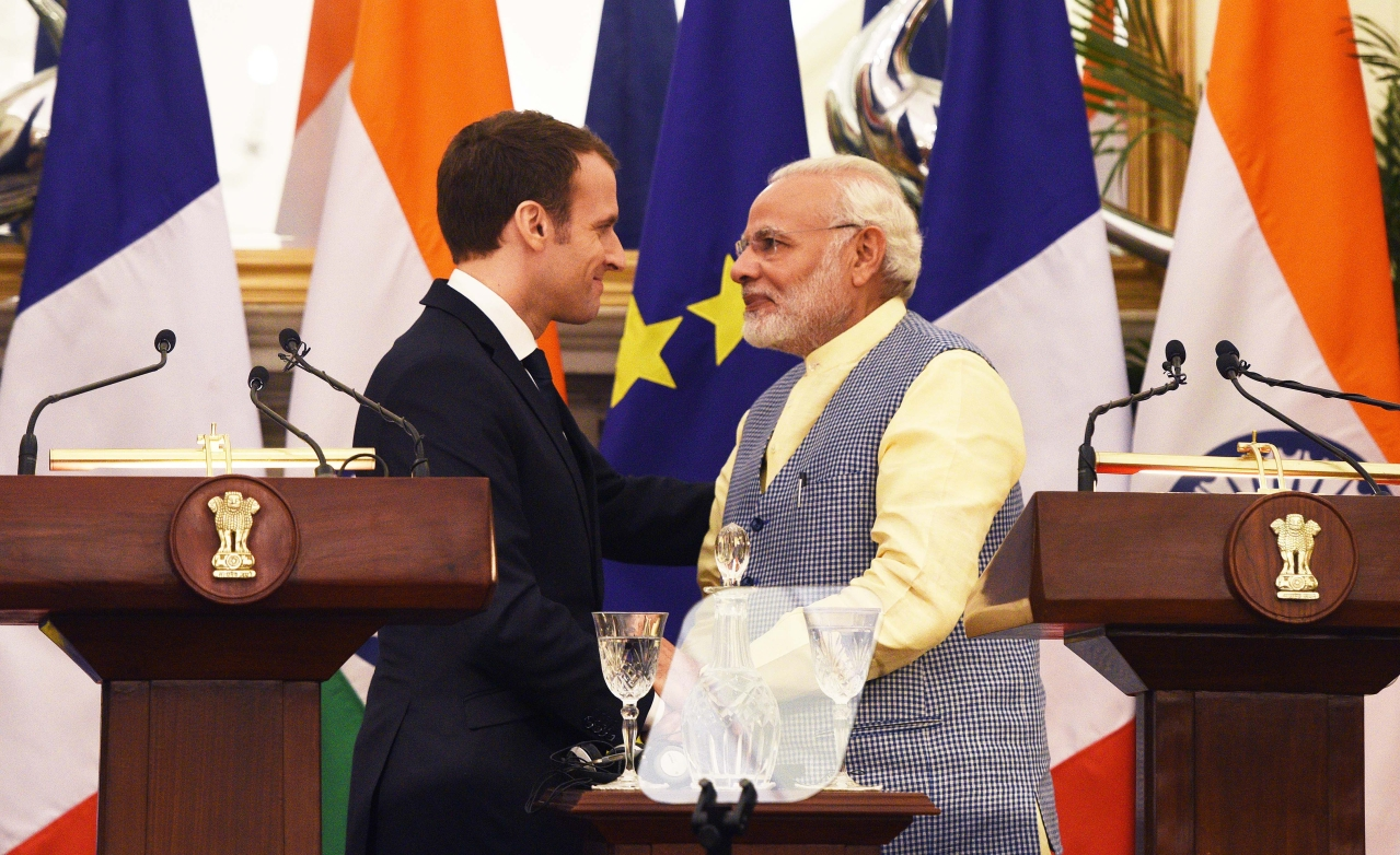 Prime Minister Narendra Modi and French President Emmanuel Macron during the ISA summit at Hyderabad House in New Delhi. (Mohd Zakir/Hindustan Times via GettyImages)