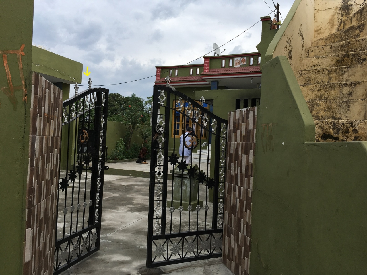 Entry to Sanji Ram's house. The yellow mark points to another gate that leads to Devasthan. This courtyard serves as a shortcut to the prayer hall for villagers.