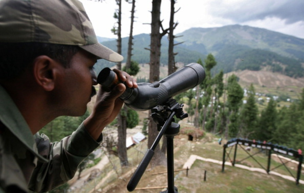 An Indian Army soldier keeps a close watch on the Line of Control in Gurez, Kashmir. (Farooq Khan-Pool/GettyImages)