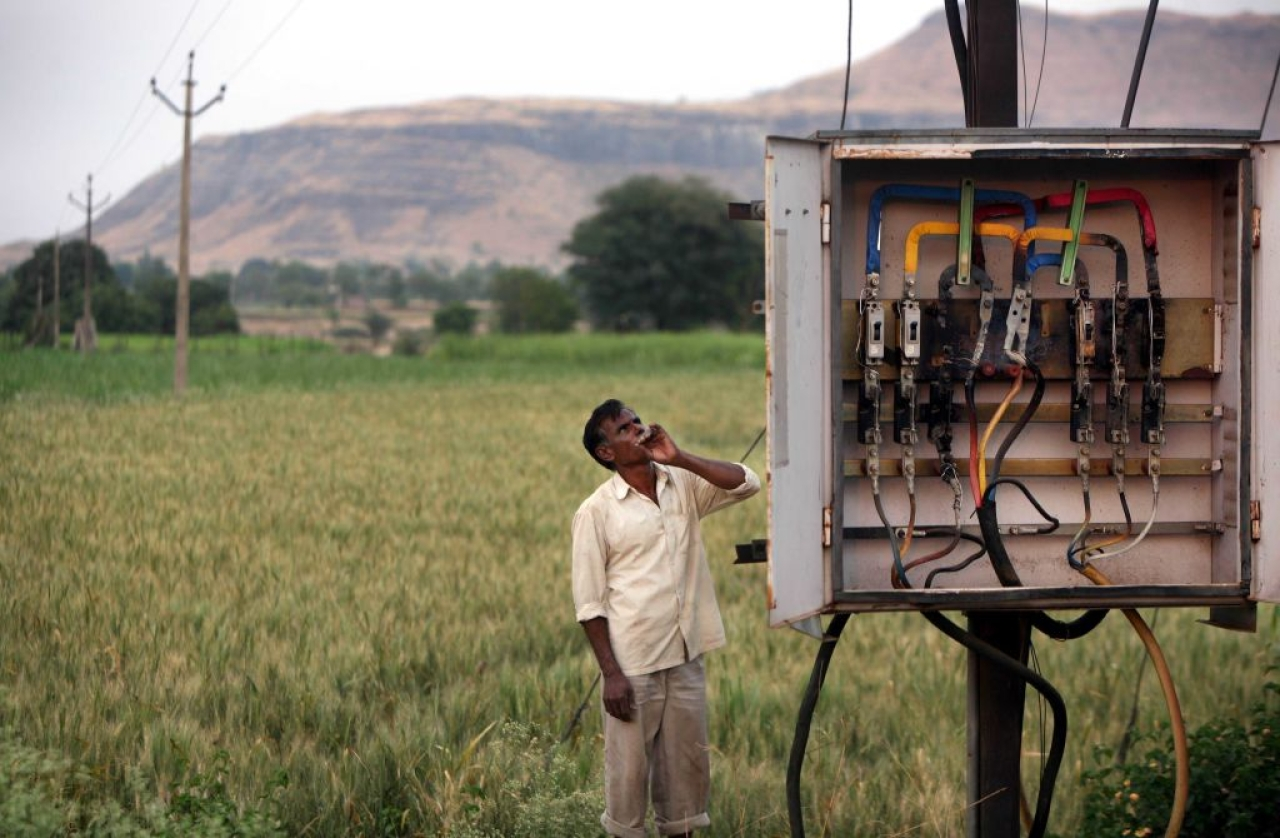 A farmer looks at a transformer next to his field in Chandapuri, Ahmednagar. (Vikas Khot/Hindustan Times via Getty Images)