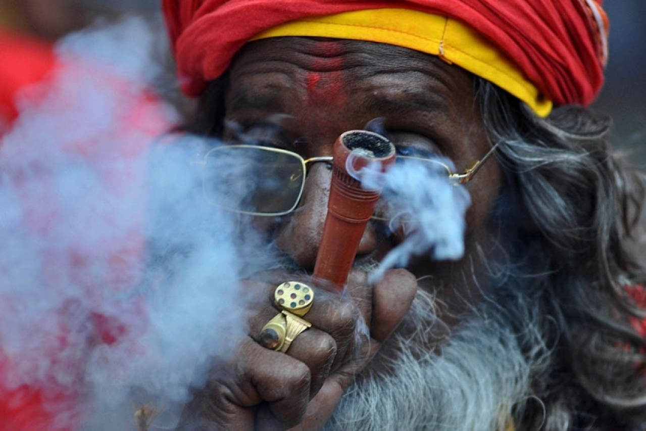 An Indian sadhu puffs cannabis (BIJU BORO/AFP/Getty Images)