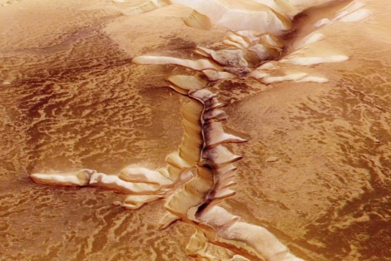 In this handout image supplied by the European Space Agency (ESA), Echus Chasma, one of the largest water source regions on Mars, is pictured from ESA's Mars Express. The dark material shows a network of light-coloured, incised valleys that look similar to drainage networks known on Earth. (ESA via GettyImages)