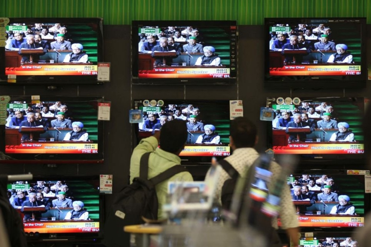 Annual Budget 2011-12 is seen on a TV Screen at the shop at Prabhadevi on Monday.(Kunal Patil/Hindustan Times via Getty Images)