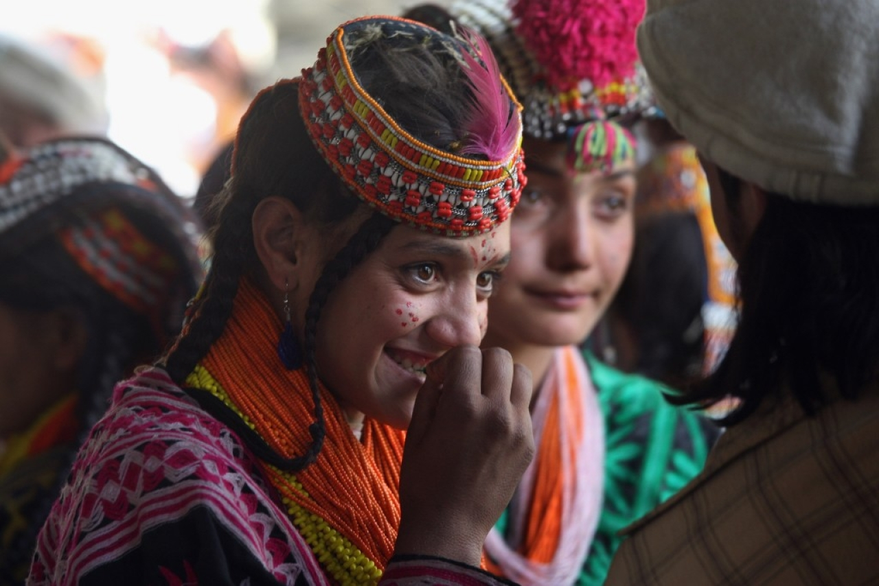 Girls and boys from the Kalash tribe during the Joshi spring festival on 15 May 2008 in the remote Chitral village of Rumbur in northwestern Pakistan. (John Moore/GettyImages)