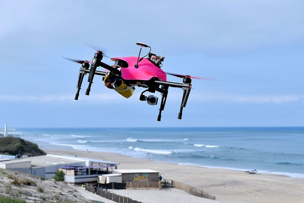 A surveillance drone flies over the beach of Biscarrosse, during a demonstration of a rescue operation. Photo credit: GEORGES GOBET/AFP/GettyImages