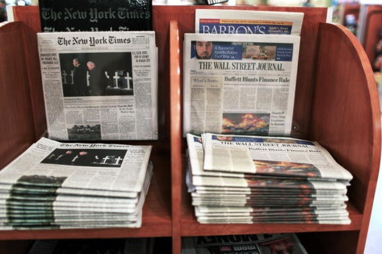 An issue of <i>The Wall Street Journal </i>is placed beside <i>The New York Times. </i>(Spencer Platt/Getty Images)