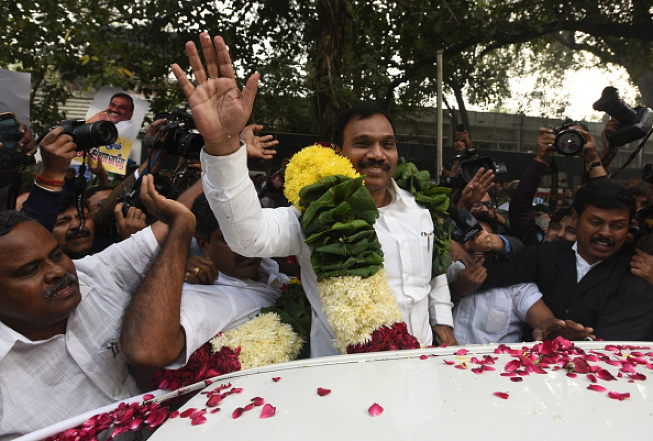 DMK Leader and former Union Telecom Minister A Raja with his supporters celebrating after 2G Case Verdict by Patiala House Court on December 21, 2017 in New Delhi. (Sonu Mehta/Hindustan Times via Getty Images)