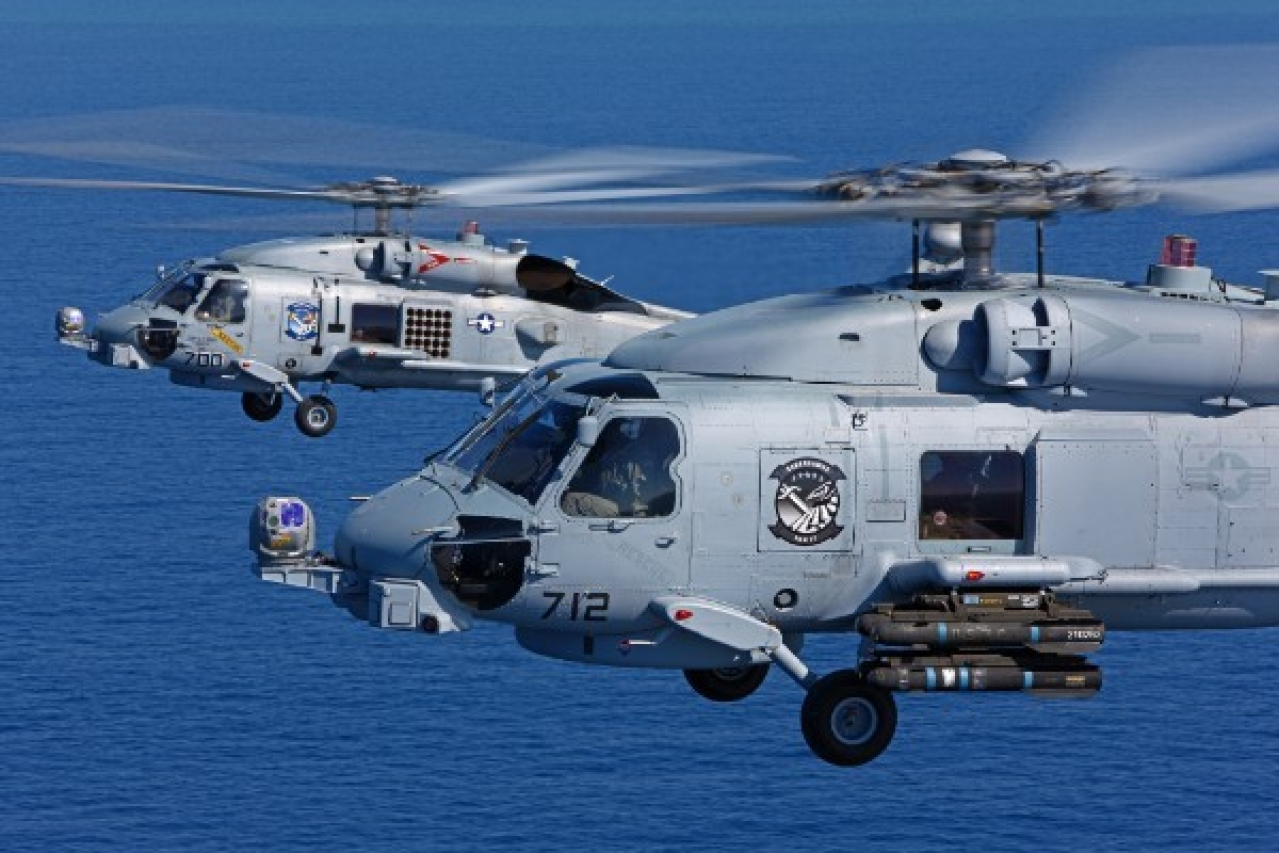 A pair of US Navy Sikorsky MH-60R Seahawks, NE 712 166556 and NE 700 166541 of HSM-77 'Sabrehawks', cruise over the Pacific Ocean (Pic: www.livefistdefence.com)