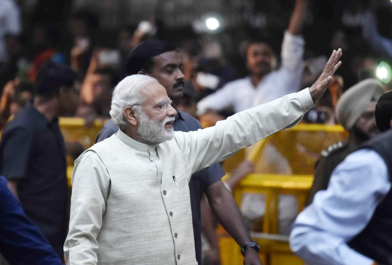 Prime Minister Narendra Modi waves to his supporters. (Ajay Aggarwal/Hindustan Times via Getty Images)