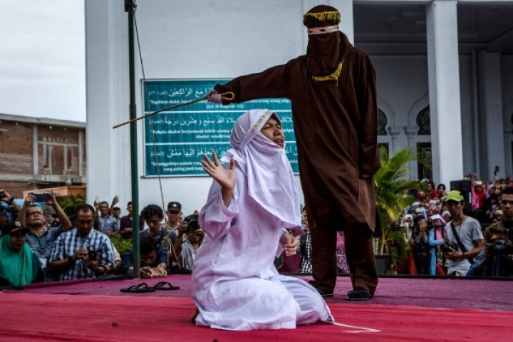 Young Indonesian Muslim Woman Faces Wrath Of Sharia, Lashed In Public For 'Getting Too Close' To Her Boyfriend