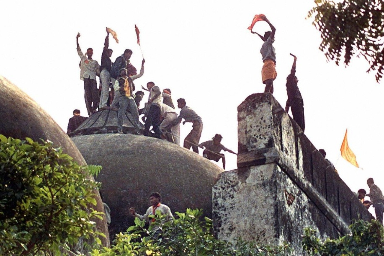 Hindu youth demolishing the disputed structure in Ayodhya.