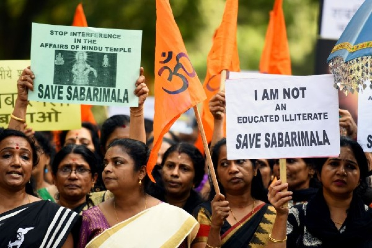 Members of Ayyappa Dharma Samrakshana Samithi hold placards during a protest against the Supreme Court verdict on the entry of women of all ages into the Sabarimala Lord Ayyappa Temple in New Delhi. (Amal KS/Hindustan Times via Getty Images)