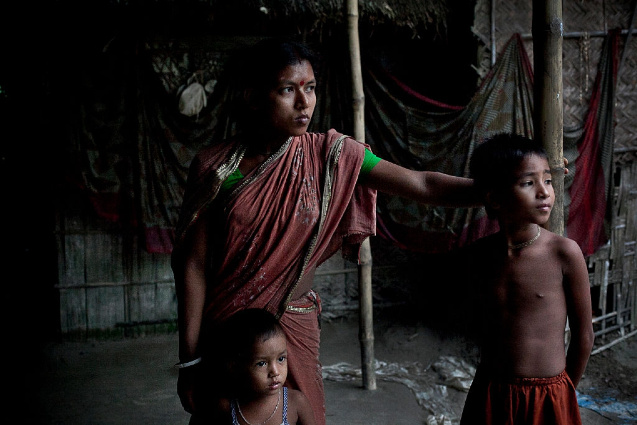 Gota Mari Indian Enclave resident Bobita Rani stands outside her home in Lalmonirhat District, Bangladesh. She and her family are Hindus and will be moving to India as citizens at the end of the month. (Shazia Rahman/Getty Images)