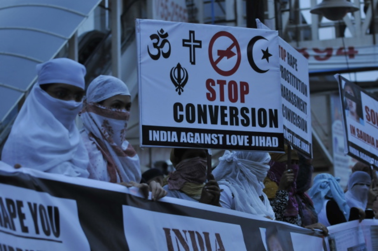 Women against love jihad hold placards to protest against the practice and conversion in Bhopal. (Mujeeb Faruqui/Hindustan Times via Getty Images)