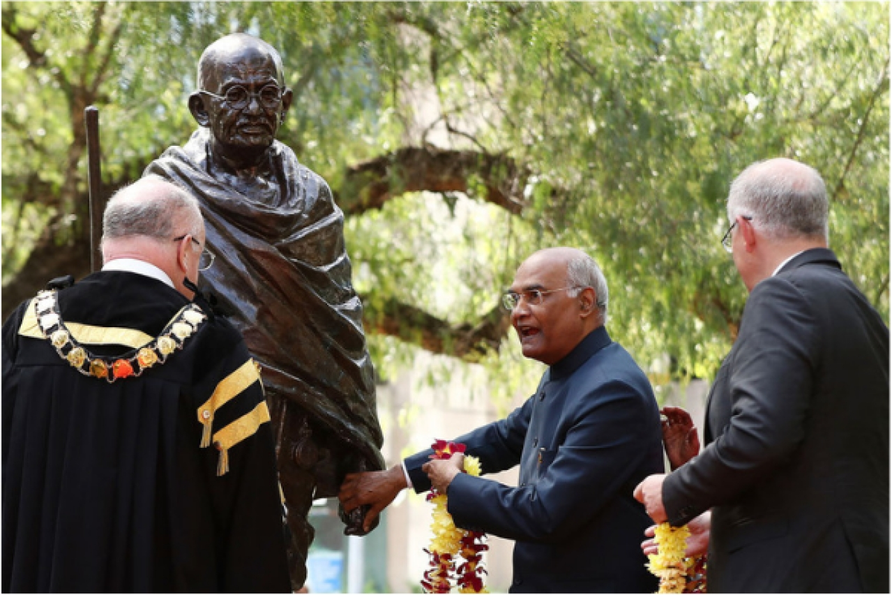 Indian President Ram Nath Kovind prepares to place a wreath of flowers on to a Gandhi Statue at Jubilee Park, Parramatta, in Sydney, Australia. (Mark Metcalfe - Pool/Getty Images)