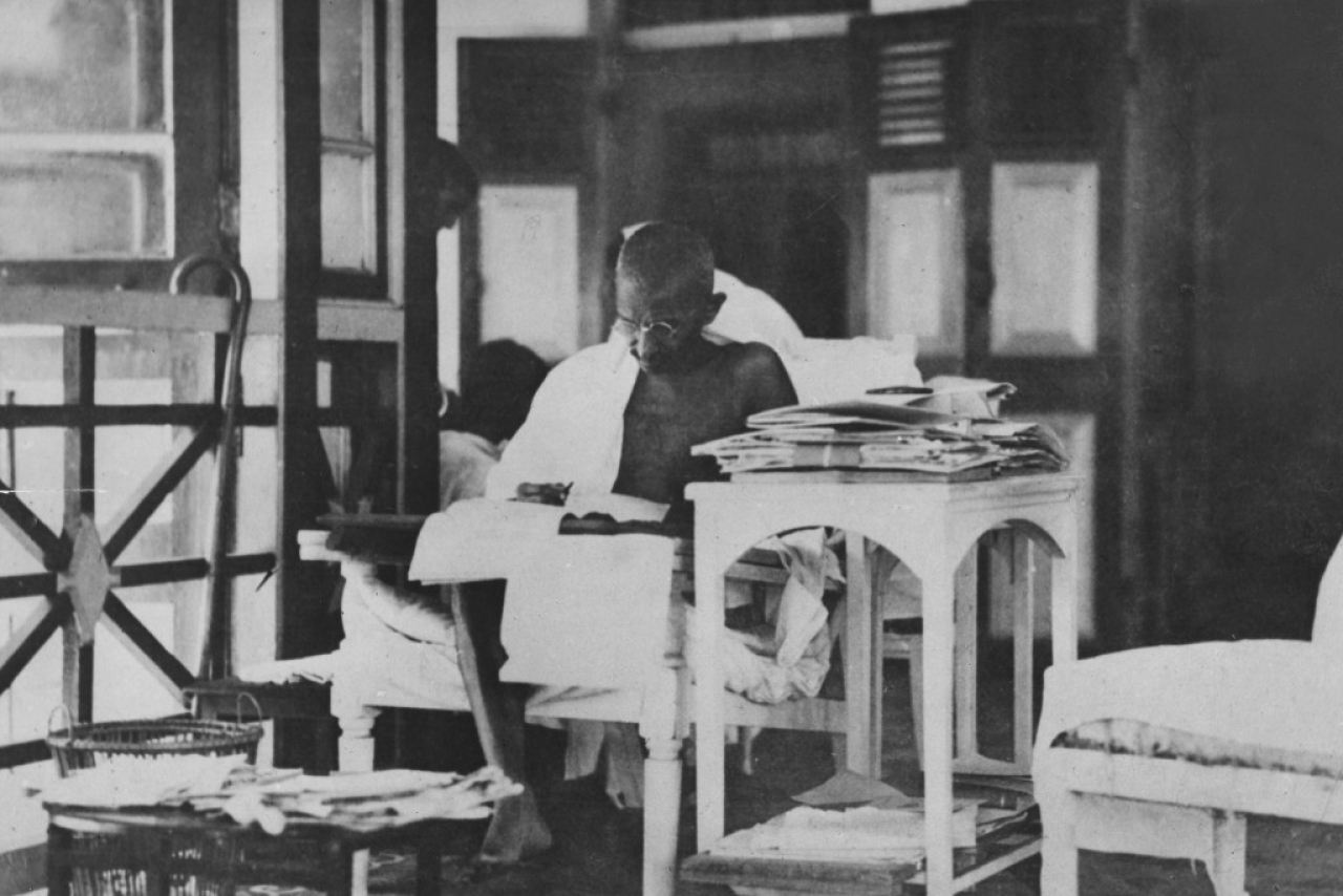 Mahatma Gandhi  reading his correspondance whilst living in seclusion after being released from prison. (Topical Press Agency/Getty Images)