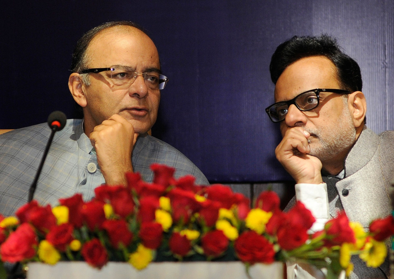Finance Minister Arun Jaitley with Revenue Secretary Finance Dr Hasmukh Adhia in New Delhi. (Sonu Mehta/Hindustan Times via GettyImages)