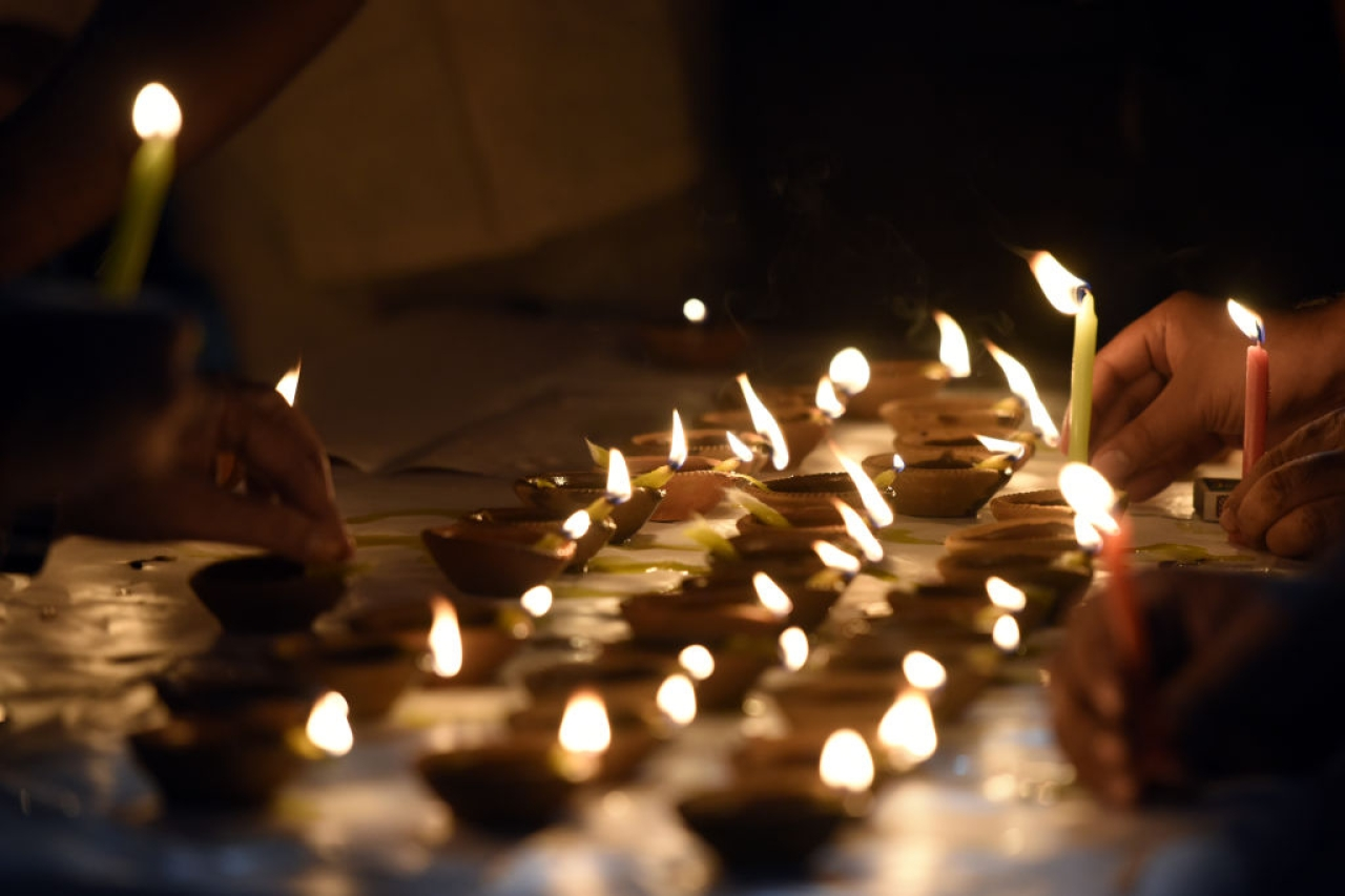 People light diyas on Diwali in New Delhi, India. (Sonu Mehta/Hindustan Times via GettyImages)