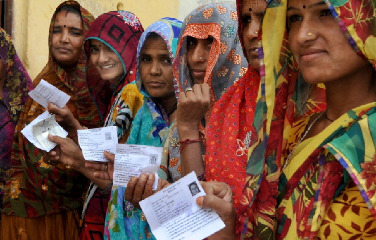 Women lined up outside a polling booth in Rajasthan (Himanshu Vyas/Hindustan Times via Getty Images)