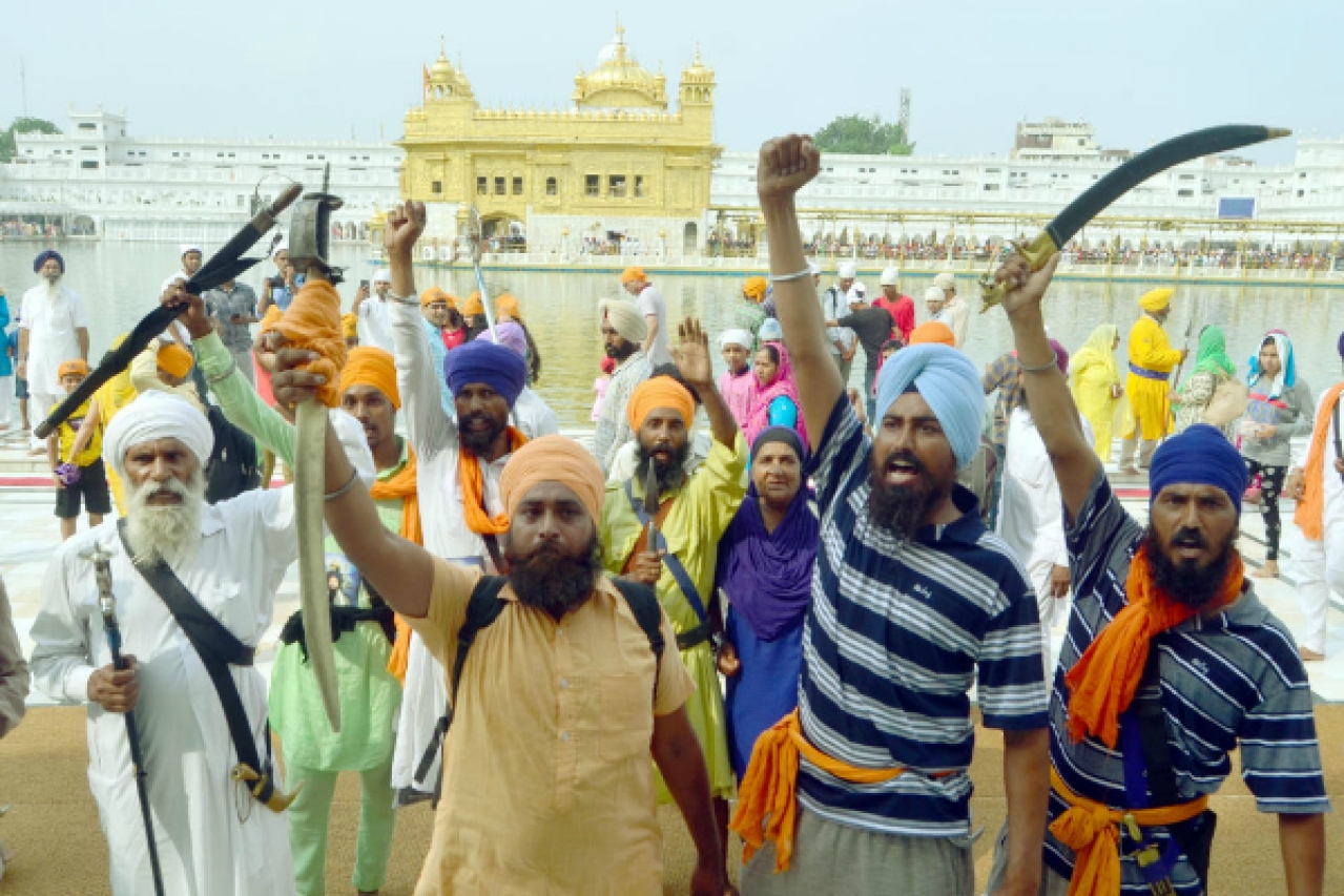 Sikh hardliners brandishing swords and raising pro-Khalistan slogans on the anniversary of Operation Blue Star at Golden Temple complex in 2018 in Amritsar. (Sameer Sehgal/Hindustan Times via Getty Images)