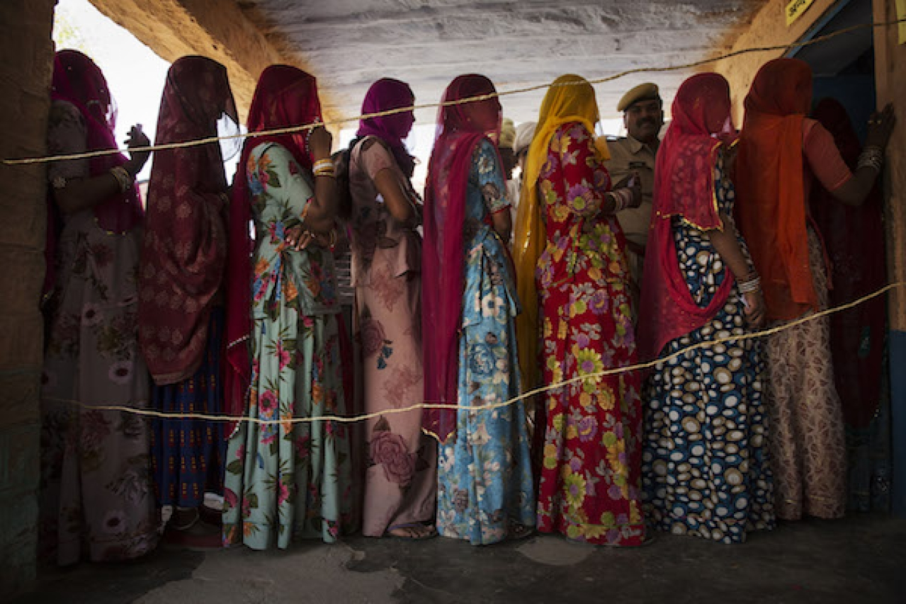 Representative image of Indian women waiting to vote at a polling station in Jodhpur, Rajasthan. (Kevin Frayer/Getty Images)